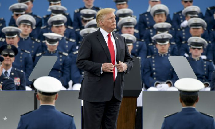 President Donald Trump waits to shake hands with United States Air Force Academy cadets as they receive their diplomas during their graduation ceremony at Falcon Stadium on May 30, 2019 in Colorado Springs, Colorado. (Michael Ciaglo/Getty Images)