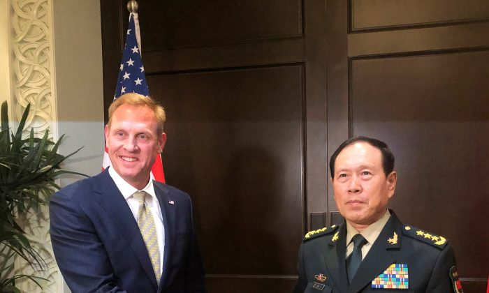 Acting U.S. Defense Secretary Patrick Shanahan and Chinese Defense Minister Wei Fenghe meet before the start of their meeting in Singapore on the sidelines of the Shangri-La dialogue on May 31, 2019. (Idrees Ali/Reuters)
