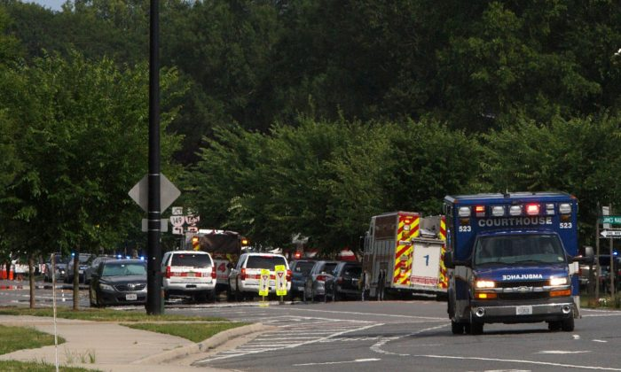 Emergency vehicles are seen near the intersection of Princess Anne Road and Nimmo Parkway following a shooting at the Virginia Beach Municipal Center in Virginia Beach, Va., on on May 31, 2019. (Kaitlin McKeown/The Virginian-Pilot via AP)
