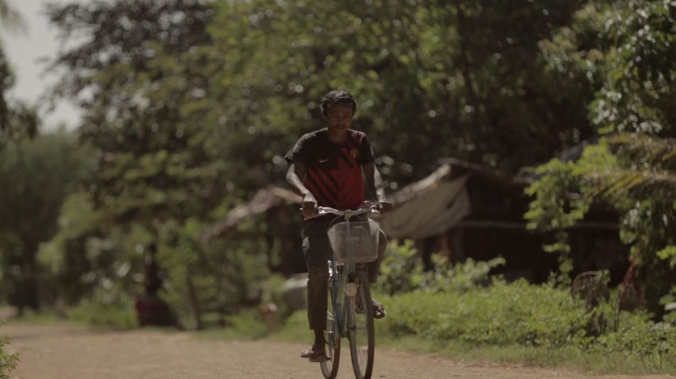 former Thai slave on bicycle