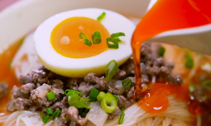 Rice noodle soup with beef and chili oil.