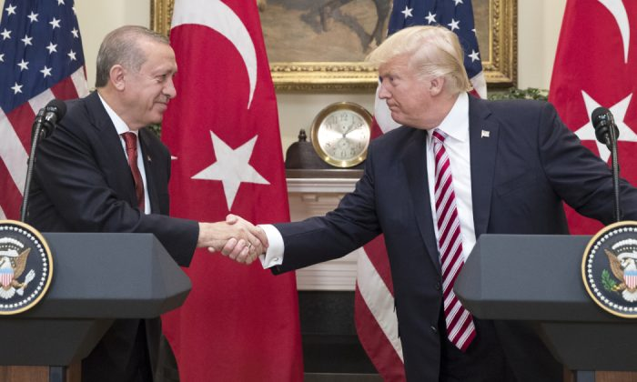 US President Donald Trump (R) shakes hands with President of Turkey Recep Tayyip Erdogan (L) in the Roosevelt Room where they issued a joint statement, at the White House in Washington, DC. on May 16, 2017. (Michael Reynolds-Pool/Getty Images)
