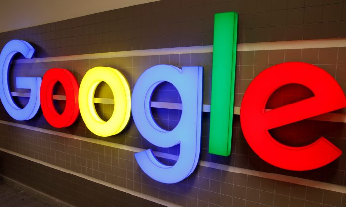 An illuminated Google logo is seen inside an office building in Zurich, Switzerland on December 5, 2018. (Arnd Wiegmann/Reuters)