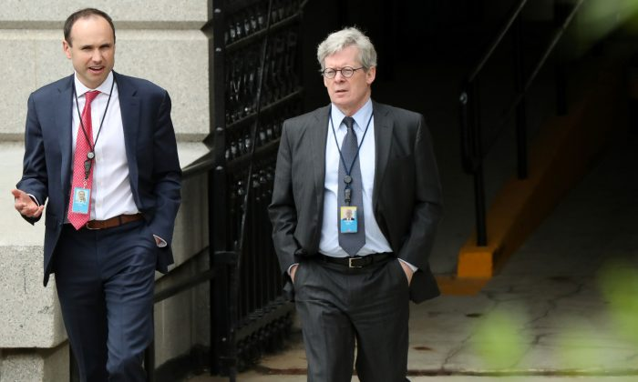White House legal counsel Emmet Flood (R), walking with Associate Counsel David Morrell, exits the Eisenhower Executive Office Building on the White House campus in Washington, U.S. May 8, 2019. (Reuters/Jonathan Ernst/File Photo)