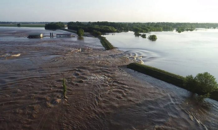 In this aerial image provided by Yell County Sheriff's Department water rushes through the levee along Arkansas River in Dardanelle, Ark., on May 31, 2019. (Yell County Sheriff's Department via AP)