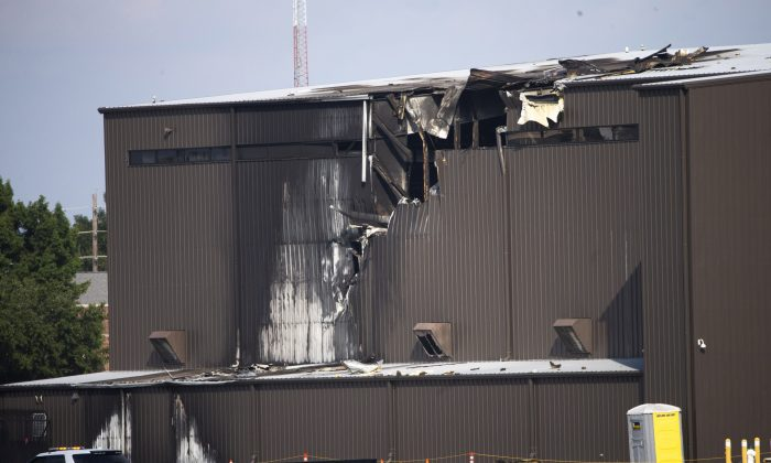 Damage is seen to a hangar after a twin-engine plane crashed into the building at Addison Airport in Addison, Texas, on June 30, 2019. (Shaban Athuman/The Dallas Morning News via AP)