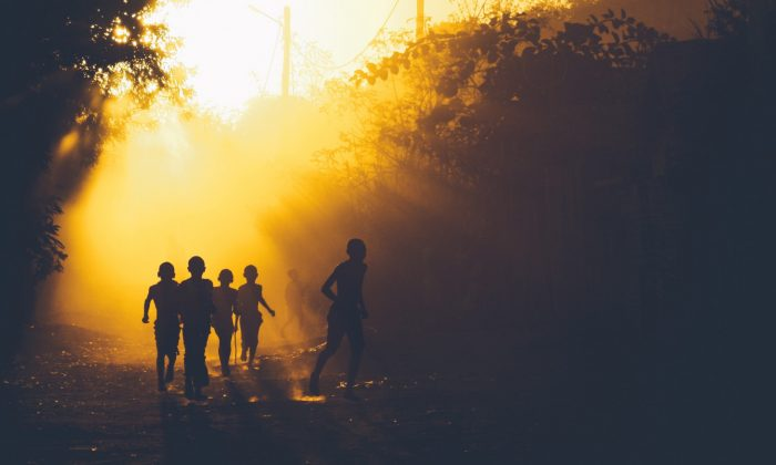 File image of children running in the woods. (Ban Yido/Unsplash)