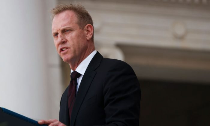 Acting Secretary of Defense Patrick Shanahan delivers remarks during a Memorial Day ceremony at Arlington National Cemetery in Arlington, Virginia, on May 27, 2019. (Tom Brenner/Getty Images)