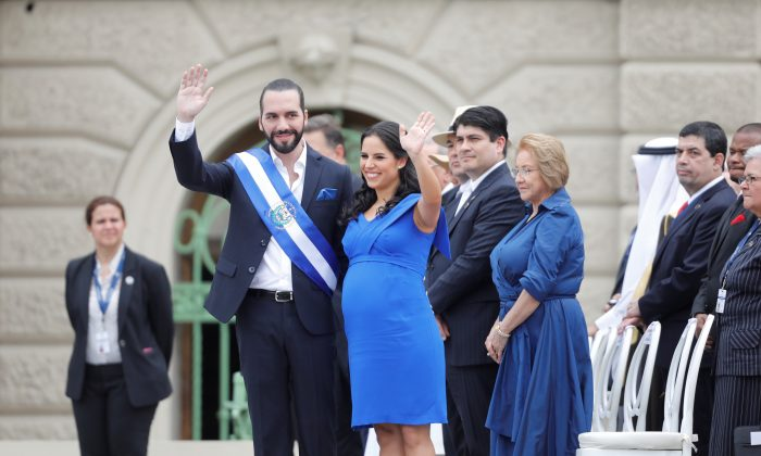 El Salvador's new President Nayib Bukele waves to the audience beside his pregnant wife, Gabriela de Bukele, after receiving the presidential sash during his swearing-in ceremony in San Salvador, El Salvador June 1, 2019. (REUTERS/Jose Cabezas)