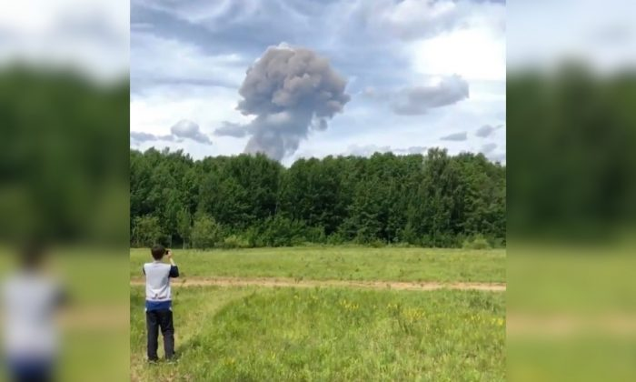 A boy takes a photo of a mushroom cloud after the blasts at an explosives plant in the town of Dzerzhinsk, Nizhny Novgorod Oblast, Russia on June 1, 2019. (INSTAGRAM / @GALYAEVA_EVGENIA/via Reuters)