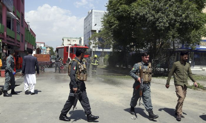 Afghan Security Police arrives at the site of explosions in Kabul, Afghanistan, on June 2, 2019. (Rahmat Gul/AP Photo)
