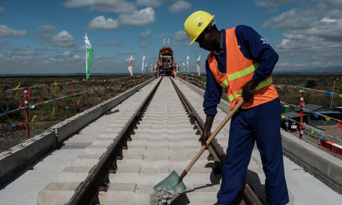 A Kenyan worker puts gravel at the construction site of Standard Gauge Railway (SGR) near Nairobi, Kenya, on June 23, 2018. (Yasuyoshi Chiba/AFP/Getty Images)