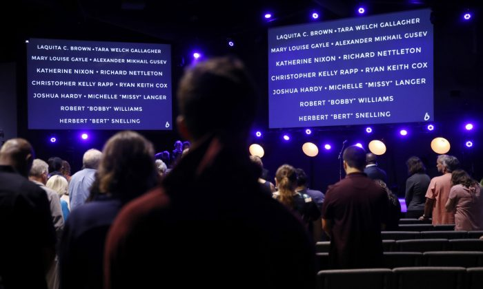 Names of victims of a mass shooting at a municipal building in Virginia Beach are displayed during a vigil at Bridge Church, on June 1, 2019, in Virginia Beach, Va. (Patrick Semansky/AP Photo)