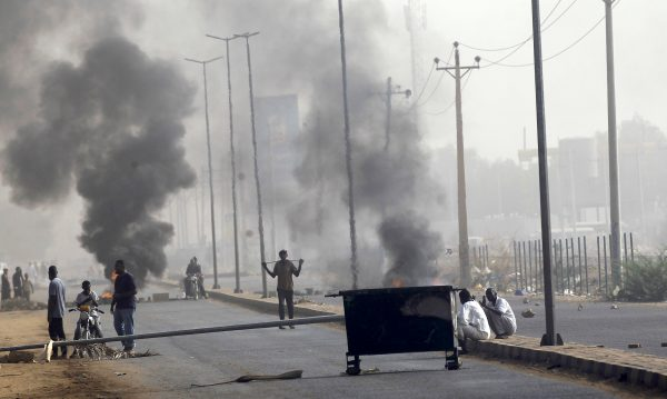 Sudanese protesters erect a barricade on a street and demanding that the country's Transitional Military Council hand over power to civilians in Khartoum