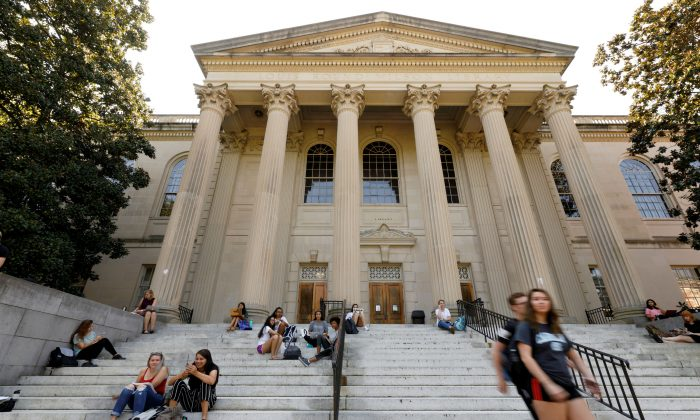 Students sit on the steps of Wilson Library on the campus of University of North Carolina at Chapel Hill, N.C., on Sept. 20, 2018. (Reuters/Jonathan Drake/File Photo)