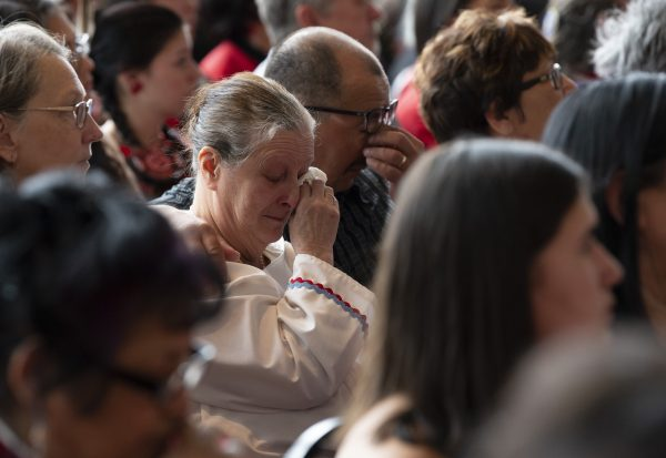 A man and woman show their emotions during ceremonies marking the release of the Missing and Murdered Indigenous Women report in Gatineau, on June 3, 2019. (Adrian Wyld/The Canadian Press)