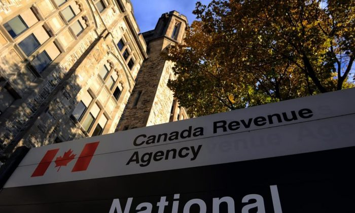 The Canada Revenue Agency headquarters in Ottawa in a file photo. A recent rise in scam callers pretending to be CRA employees has been bilking money from Canadians across the country. (Sean Kilpatrick/The Canadian Press)