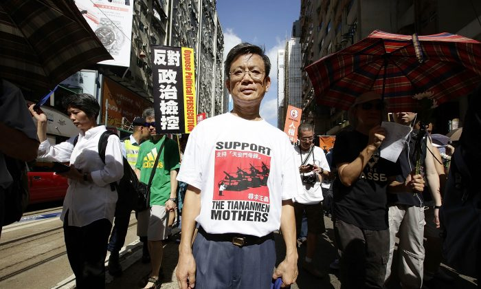 Pro-democracy activists march to mark the 25th anniversary of Tiananmen Square massacre, in Hong Kong on June 1, 2014. The protest wound its way from Victoria Park, Causeway Bay, to finish at the Government Offices in Admiralty. (Photo by Jessica Hromas/Getty Images)