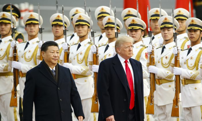 President Donald Trump during a welcoming ceremony with Chinese leader Xi Jinping in Beijing on Nov 9, 2017. The Chinese regime's recent white paper on trade severely criticized the U.S. administration for allegedly backtracking on several trade commitments, and refuted allegations that it reneged on promises made over months of negotiations. (Thomas Peter-Pool/Getty Images)