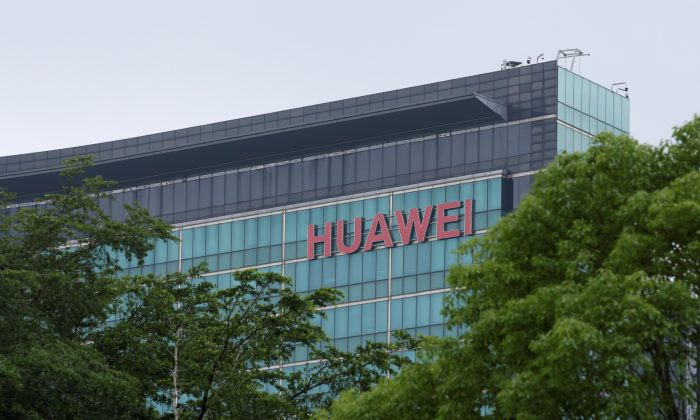 A Huawei logo is seen on the side of a building at the headquarters in Shenzhen, Guangdong Province, China on May 30, 2019. (Jason Lee/Reuters)