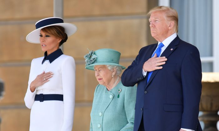 Queen Elizabeth II stands with President Donald Trump and first lady Melania Trump during a welcome ceremony at Buckingham Palace in London on June 3, 2019. (Toby Melville - WPA Pool/Getty Images)