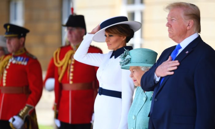 (L-R) First Lady Melania Trump, Queen Elizabeth II and President Donald Trump during the Ceremonial Welcome at Buckingham Palace on the first day of the U.S. President and First Lady's three-day State visit in London, England on June 3, 2019. (Victoria Jones/WPA Pool/Getty Images)