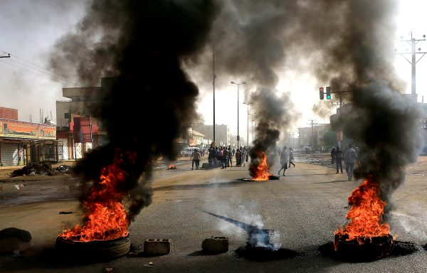 Sudanese protesters use burning tyres to erect a barricade on a street, demanding that the country's Transitional Military Council hand over power to civilians, in Khartoum