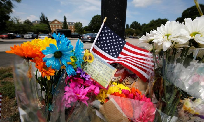 A card lists the names of the victims at a makeshift memorial outside a municipal government building where a shooting incident occurred in Virginia Beach, Vir., U.S. on June 1, 2019.  (Jonathan Drake/Reuters)