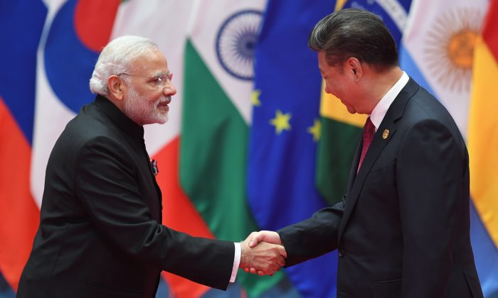 India's Prime Minister Narendra Modi (L) shakes hands with China's leader Xi Jinping before the G-20 leaders' family photo in Hangzhou, China, on Sept. 4, 2016. (Greg Baker/AFP/Getty Images)