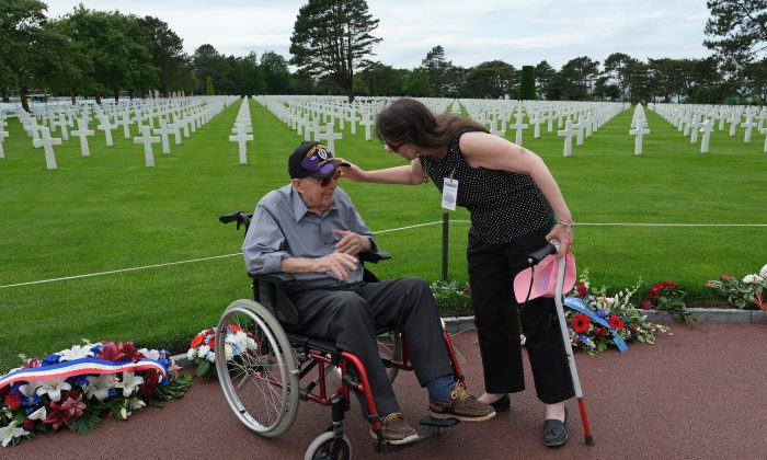U.S. D-Day veteran Leonard Jindra, 98, speaks with his daughter following a ceremony at Normandy American Cemetery near Colleville-sur-Mer, France, on June 2, 2019.  (Sean Gallup/Getty Images)
