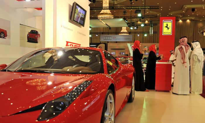Saudi men visit the Ferrari stand at the International Luxury Motor Show in Jeddah in a file photo. (Amer Hilabi/AFP/Getty Images)