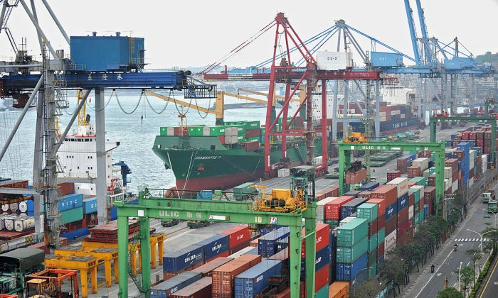 Cargo containers are unloaded at the Keelung port in Taiwan on Dec. 7, 2010. (Patrick Lin/AFP/Getty Images)