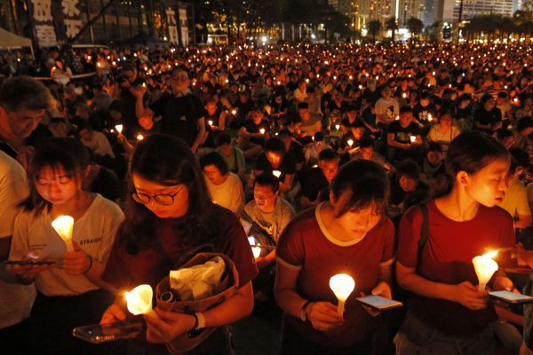 Thousands of people attend a candlelight vigil for victims of the Chinese government's brutal military crackdown three decades ago on protesters in Beijing's Tiananmen Square at Victoria Park in Hong Kong, June 4, 2019. (AP Photo/Kin Cheung)
