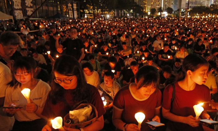 Thousands of people attend a candlelight vigil for victims of the Chinese government's brutal military crackdown three decades ago on protesters in Beijing's Tiananmen Square at Victoria Park in Hong Kong, June 4, 2019. (Kin Cheung/AP Photo)