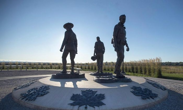 The monument honouring RCMP Constables Fabrice Gevaudan, Dave Ross and Doug Larche, gunned down in 2014, is seen in Moncton, N.B. on September 29, 2017. (Andrew Vaughan/The Canadian Press)