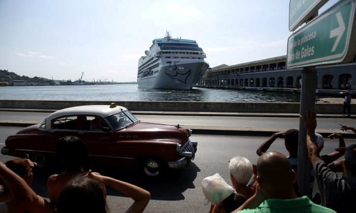 People look at the arrival of U.S. Carnival cruise ship Adonia at the Havana bay, the first cruise liner to sail between the United States and Cuba since Cuba's 1959 revolution, Cuba, on May 2, 2016. (Alexandre Meneghini/File Photo/Reuters)