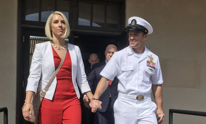 Navy Special Operations Chief Edward Gallagher leaves a military courtroom on Naval Base San Diego with his wife, Andrea Gallagher in San Diego on May 31, 2019. (Julie Watson/AP)