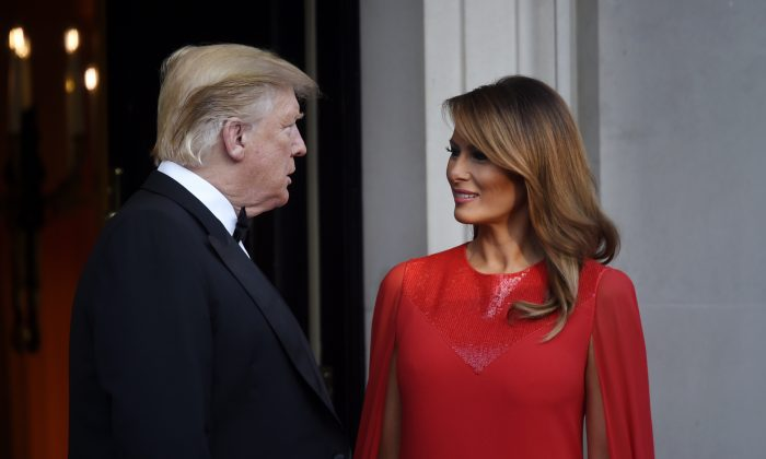 US President Donald Trump and First Lady Melania Trump pose ahead of a dinner at Winfield House for Prince Charles, Prince of Wales and Camilla, Duchess of Cornwall, during their state visit in London, England on June 4, 2019 (Peter Summers/Getty Images)