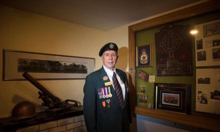 D-Day veteran Jim Parks, 94, poses for a photograph at the Mount Albert Legion in East Gwillimbury, ON. on May 30, 2019. (Tijana Martin/The Canadian Press)