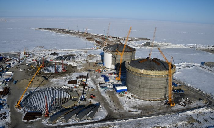 Natural gas reservoirs are seen under construction at the port of Sabetta in the Kara Sea shore line on the Yamal Peninsula in the Arctic circle on April 16, 2015. (Kirill Kudryavtsev/AFP/Getty Images)