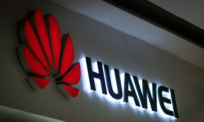A Huawei logo at a retail store in Beijing on May 23, 2019. (Fred Dufour/AFP/Getty Images)