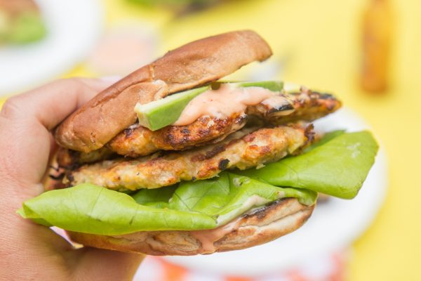 turkey burgers with cholula sauce close up