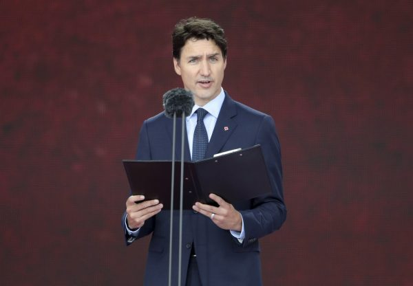 Canadian Prime Minister Justin Trudeau speaks during commemorations for the 75th Anniversary of the D-Day landings, in Portsmouth, England, on June 5, 2019. (Andrew Matthews/PA via AP/The Canadian Press)