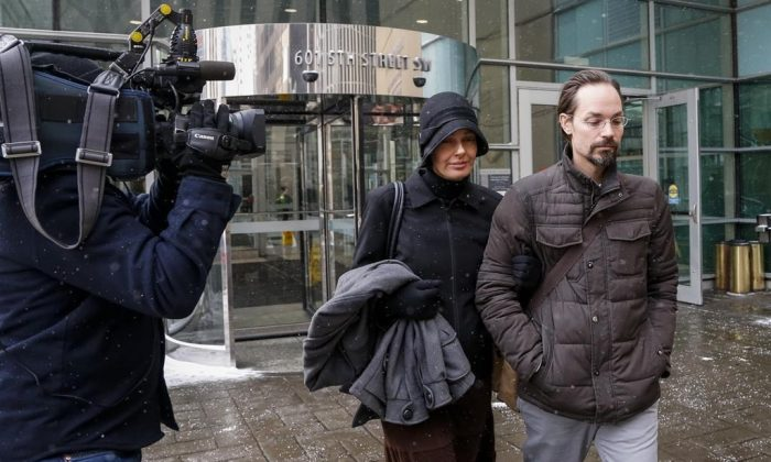 Jennifer and Jeromie Clark, leave a sentencing hearing after to couple were found guilty of criminal negligence causing the death of their 14-month-old son in 2013, outside the courts centre in Calgary on Feb. 8, 2019. (Jeff McIntosh/The Canadian Press)