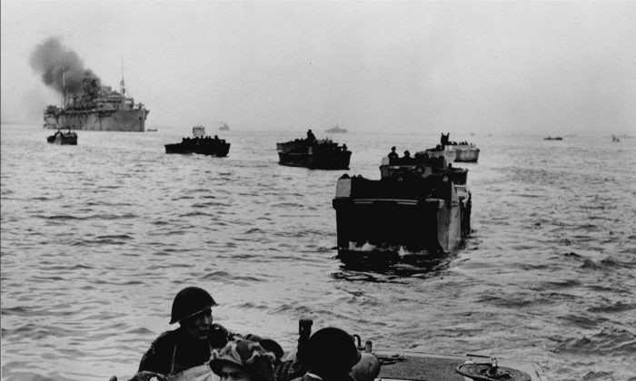 Canadian troops in the course of D-Day landings on the Normandy coastline, France, on June 6, 1944. (National Archives of Canada/CP Photo)