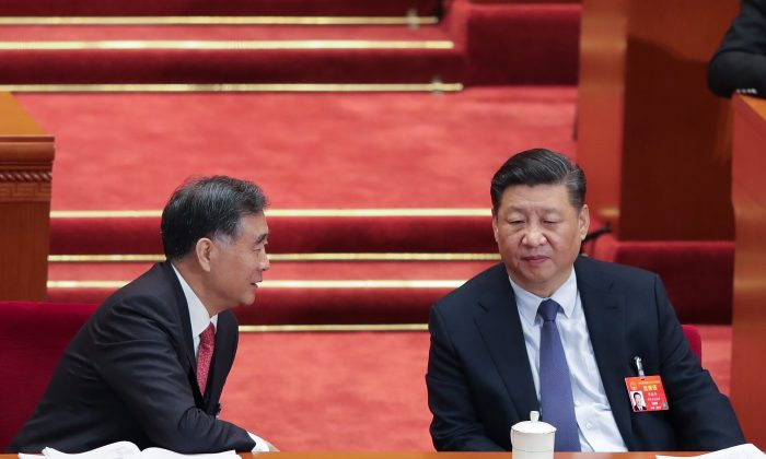 Chinese leader Xi Jinping (R) speaks with the Chairman of the Chinese People's Political Consultative Conference Wang Yang (L) during the opening of the second session of the 13th National People's Congress at the Great Hall of the People on March 5, 2019 in Beijing, China. (Lintao Zhang/Getty Images)