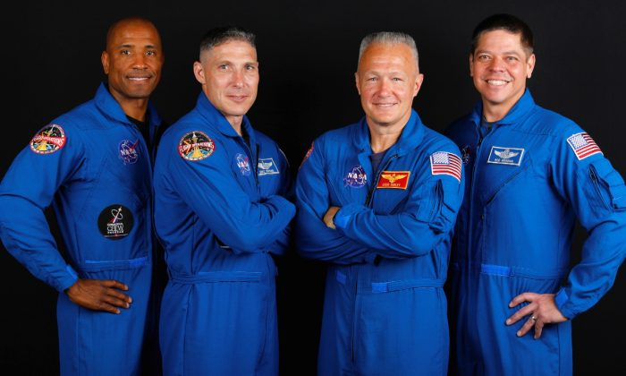 NASA commercial crew astronauts Victor Glover, Michael Hopkins, Douglas Hurley and Bob Behnken pose for a portrait at Johnson Space Center in Houston, Texas on May 21, 2019. (Mike Blake/Reuters)