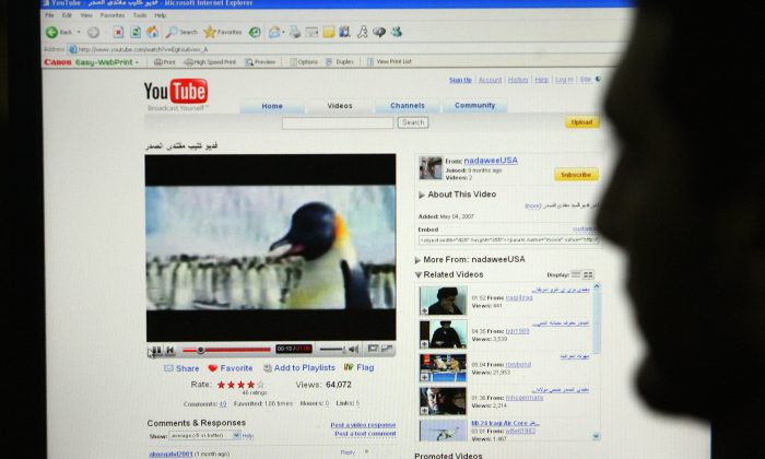 A man watches a YouTube video on Jan. 29, 2008. (AFP/Getty Images)