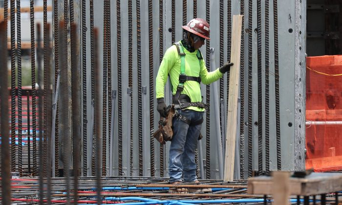 A construction worker is seen at work in Fort Lauderdale, Fla., on May 03, 2019. (Joe Raedle/Getty Images)