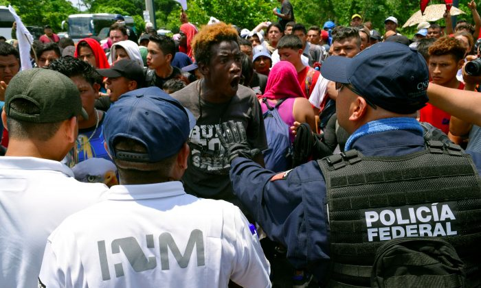 A migrant argues with a federal police officer during a joint operation by the Mexican government to stop a caravan of Central American migrants on their way to the United States, at Metapa de Dominguez, in Chiapas state, Mexico, on June 5, 2019. (Jose Torres/Reuters)